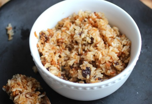 "<span class=""p-name"">Arroz con Coco Titoté (Rice with Coconut and Raisins)</span>"