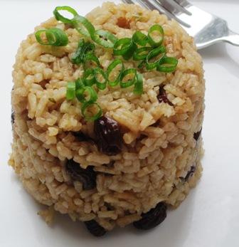 arroz con Cola y pasas
