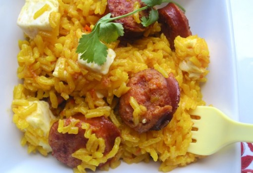 "<span class=""p-name"">Arroz Clavado (Rice with Smoked Sausage and White Cheese)</span>"