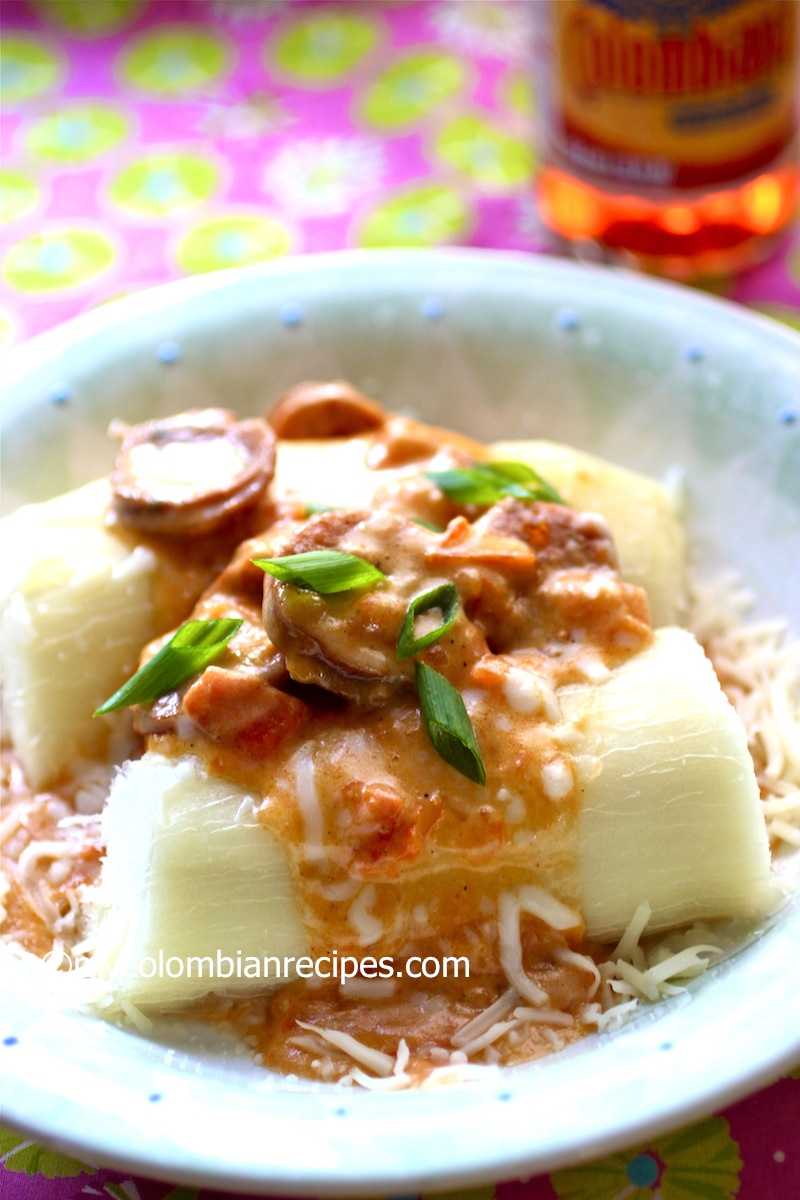 (Cassava with Chorizo and Cheese Sauce)