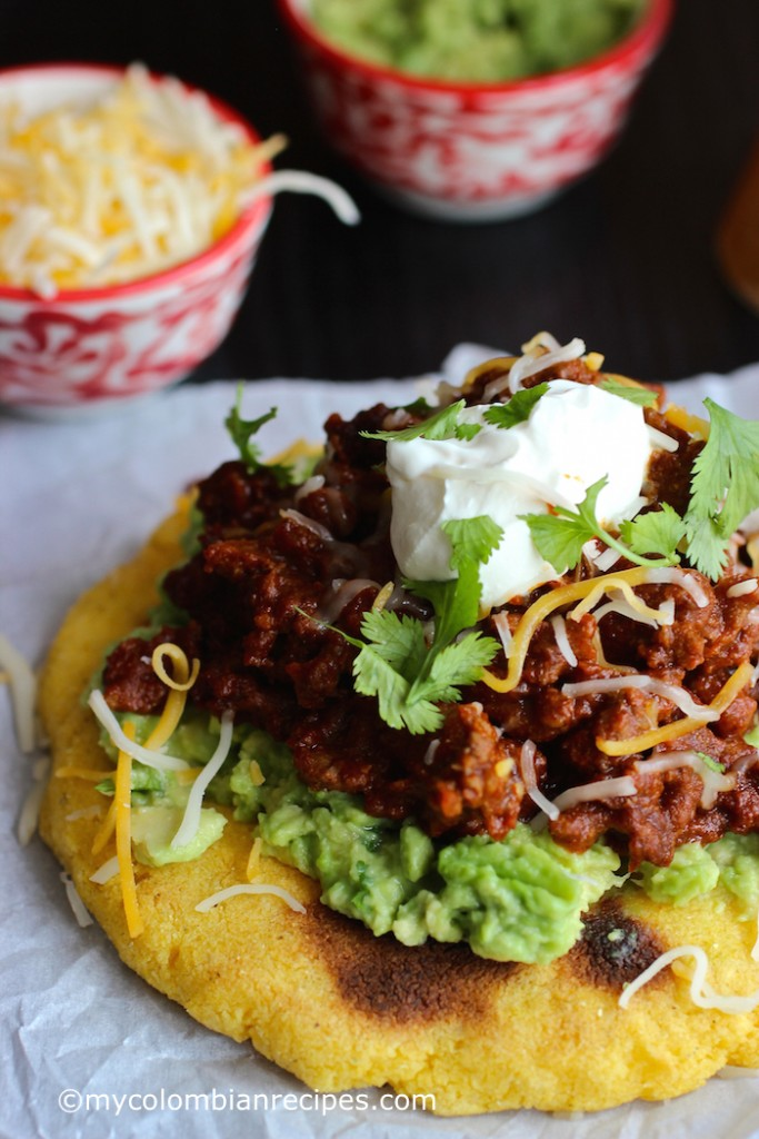 Arepas with Beef Chili, Guacamole and Cheese  mycolombianrecipes.com